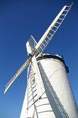 Ballycopeland Windmill Sail Against Sky poster