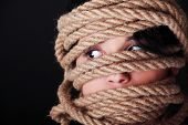 foto of kidnapped  - Tied up scared woman face - JPG