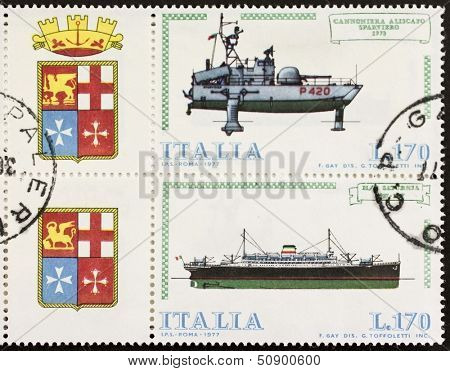 ITALY �¢?? CIRCA 1977: a block of two stamps printed in Italy shows illustrations of  Italian old hydrofoil gunboat and cruise ship and coat of arms of Italian Royal Navy. Italy, circa 1977