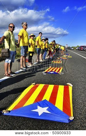 AMETLLA DE MAR, SPAIN - SEPTEMBER 11: Partakers in the Catalan Way on September 11, 2013 in Ametlla, Spain. 1,6 million people took part in the human chain supporting the independence of Catalonia