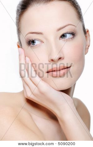 Woman Stroking Her Beautiful Face