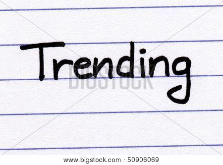 Trending written in black ink on white lined paper.