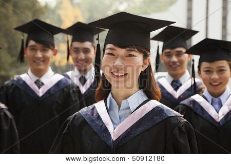 Young Graduates in Cap and Gown