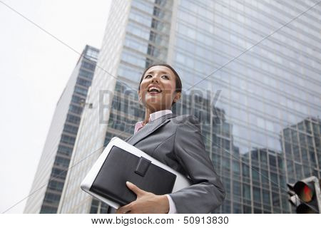 Young businesswoman walking down the street