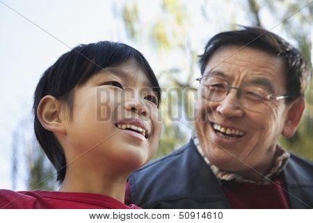 Grandfather and grandson fishing portrait