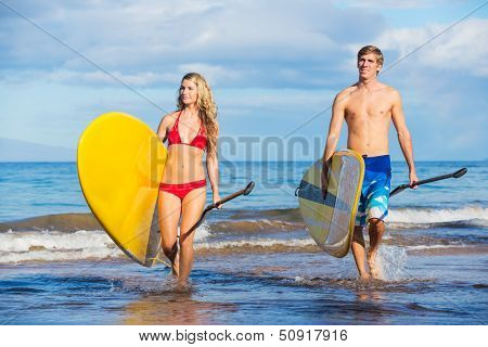 Attractive Couple Stand Up Paddling in Hawaii, Active Life Concept