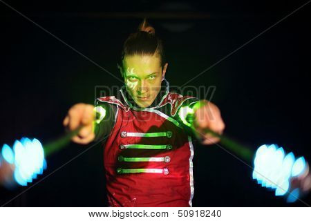 Man with tattoo and terrible pupils in samurai garb with glow sticks