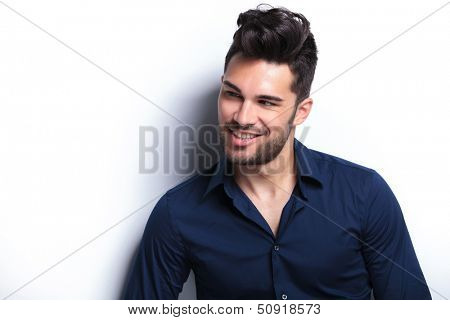 closeup portrait of a young fashion man making a goofy face. on a white background