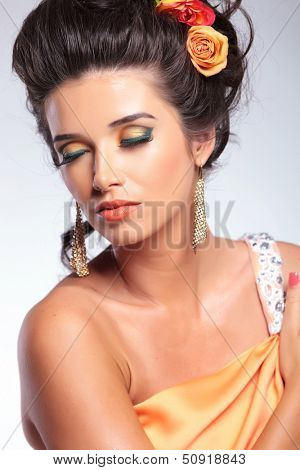 closeup portrait of a young fashion woman with closed eyes. on gray background