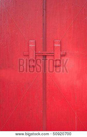 The red door with wood lock.