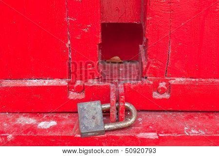 The red door with lock.