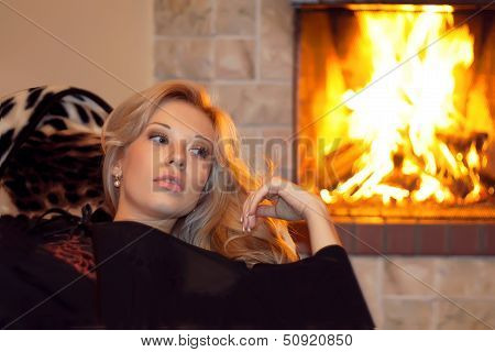 A Woman Near The Fireplace