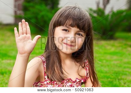 Beautiful Little Girl Waves Her Hand