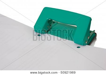 The green puncher  paper on isolated background.
