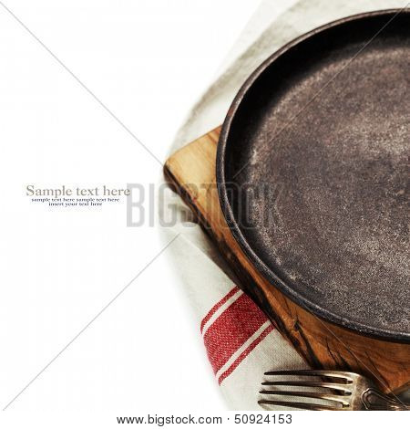 old cast iron frying pan over white