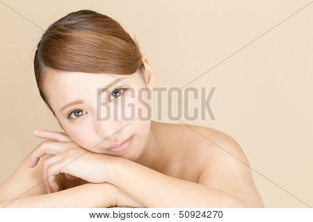 Beautiful young woman isolated on beige background