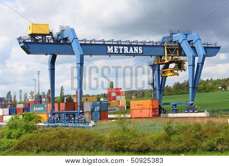 NYRANY, CZECH REPUBLIC - MAY 25: Big container terminal on a railroad with open storage area 50 000 sqm. Terminal has a capacity of 40 trucks/day. May 25, 2013 in Nyrany, Czech Republic.