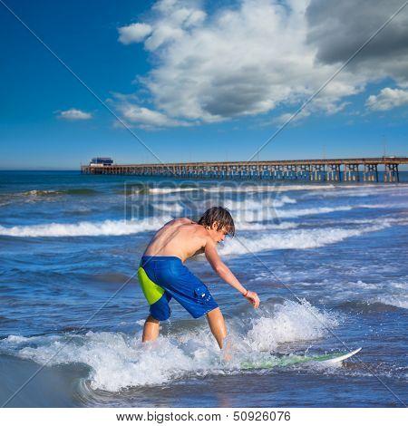 Boy surfer surfing waves on Newport pier beach  California [photo-illustration]