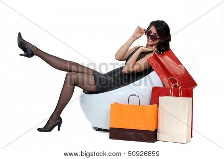 woman sitting next to bags