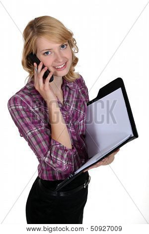 Secretary on the phone holding a folder