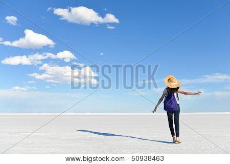 Girl in vacation with vast white salt flats background in Bonneville, Utah