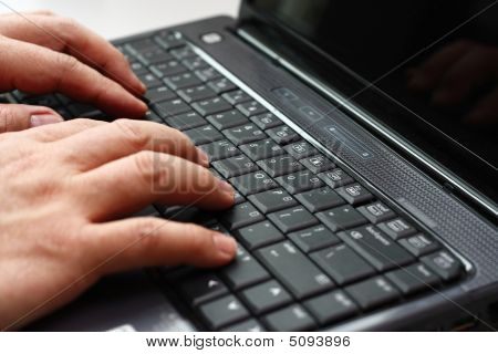 Typing On A Laptop Computer