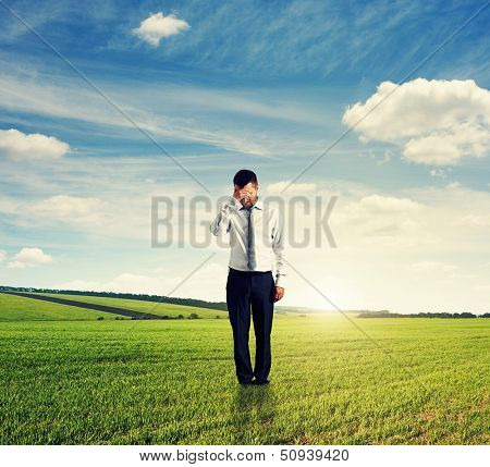 unsuccessful businessman standing on the field