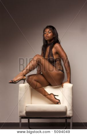 Ethnic Latina Sensual Woman In Lingerie On Chair