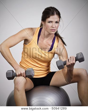 Strong Beautiful Woman Lifting free weights