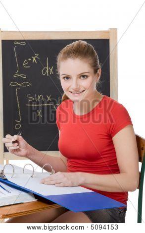Caucasian Schoolgirl By Desk Studying Math