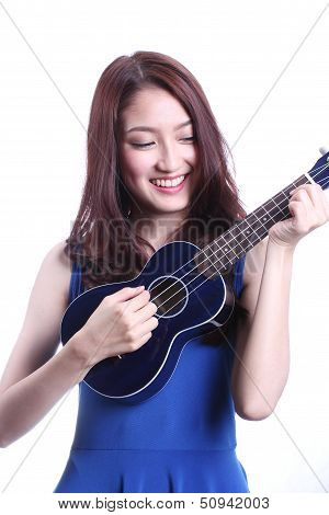 woman playing ukulele