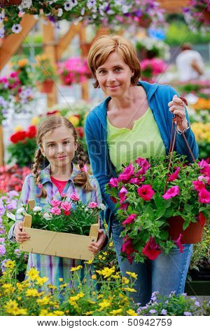 Flowers for garden - Mother with daughter shopping plants and flowers in garden center