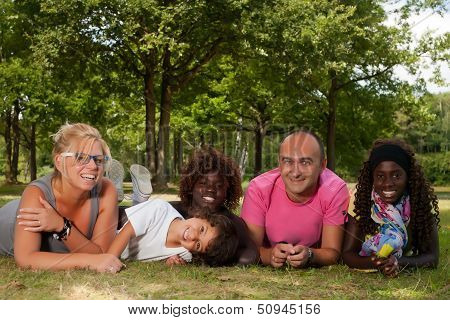 Ethnic Family On The Grass