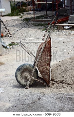 Wheelbarrow At Construction Site At Siesta Time