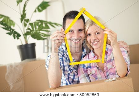 Happy smiling couple moving into first new home
