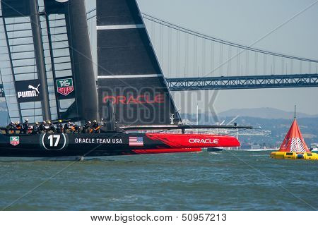 SAN FRANCISCO, CA - SEPTEMBER 12: Oracle Team USA crosses finish line in the America's Cup race in San Francisco, CA on September 12, 2013