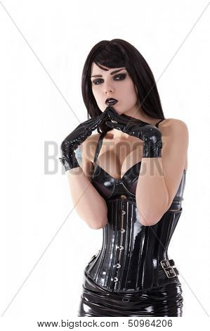 Portrait of gothic girl wearing latex clothes, isolated on white background