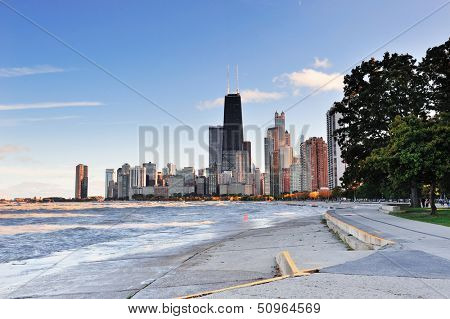 Chicago city urban skyscraper at downtown lakefront at sunset with Lake Michigan viewed from North Avenue Beach.