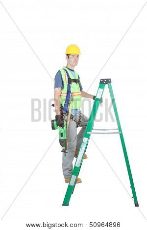 Construction Worker On Ladder With Power Tool