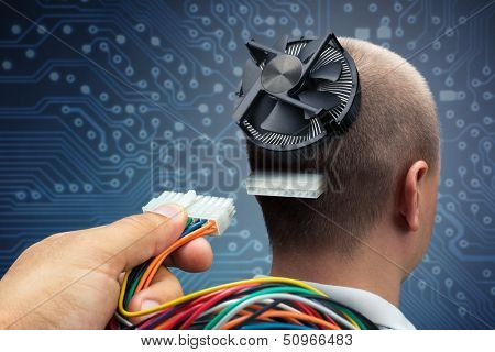 Hand plugging power cables into the head of cyborg