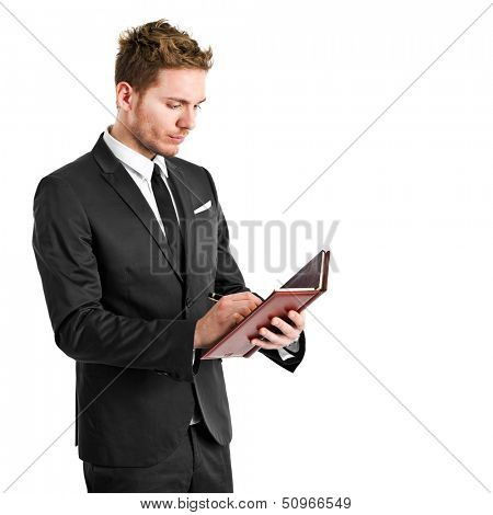 Man writing on his agenda