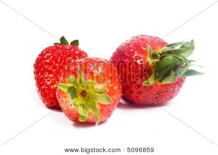 3 Strawberries On A White Background