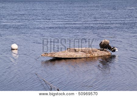 The Gray Skiff with an outboard motor.