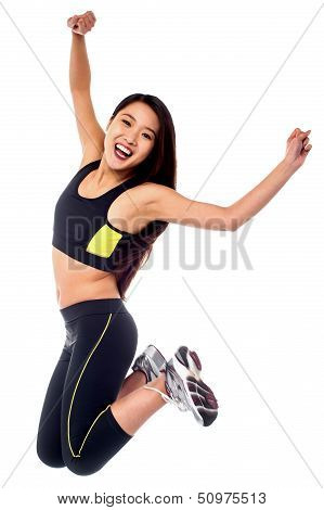 Girl In Sportswear Jumping With Joy
