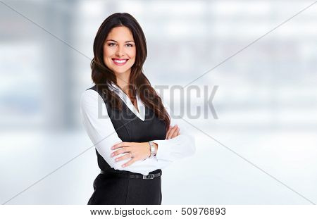 Young beautiful business woman. Over blue background.
