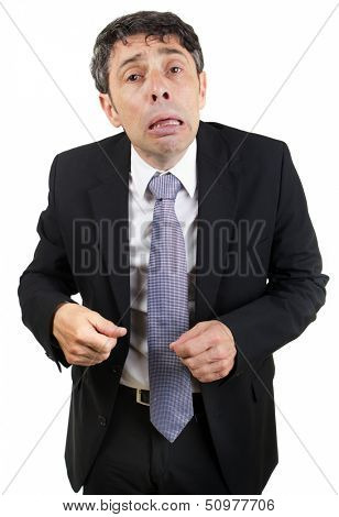 Grief-stricken businessman crying standing looking at the camera with a pitiful woebegone expression , isolated on white