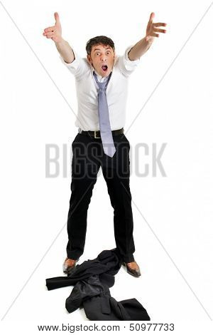 Mature businessman throwing his jacket down on the floor in frustration and anger and raising his arms in the air belligerently isolated on white