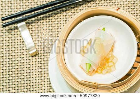 Chinese Steamed red grouper with asparagus dumplings dimsum in bamboo containers traditional cuisine