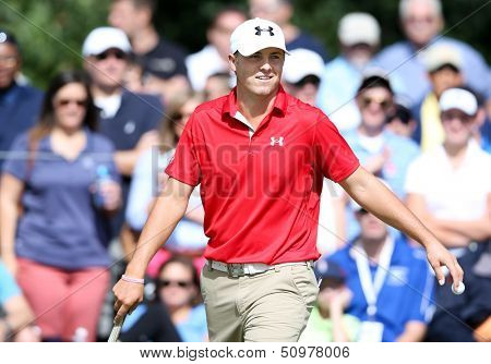 Sep 15, 2013; Lake Forest, IL, USA; Jordan Spieth walks off the ninth green during the third round of the BMW Championship at Conway Farms Golf Club.