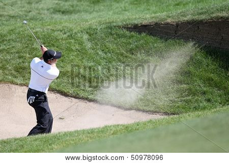 Sep 15, 2013; Lake Forest, IL, USA; Sergio Garcia hits out of a bunker on the eighth hole during the third round of the BMW Championship at Conway Farms Golf Club.
